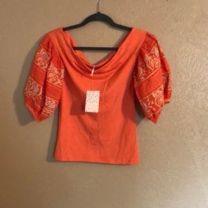 New free people top embroidered on the sleeve